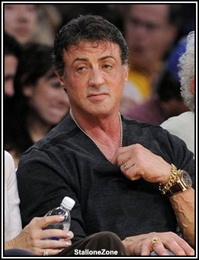 Actor Sylvester Stallone watches the Los Angeles Lakers' NBA basketball game